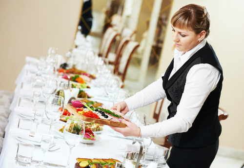 Image of a waitress offering professional Catering in Sydney