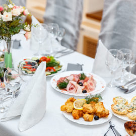 Image of a Beautifully decorated catering banquet table with different food snacks and appetizer