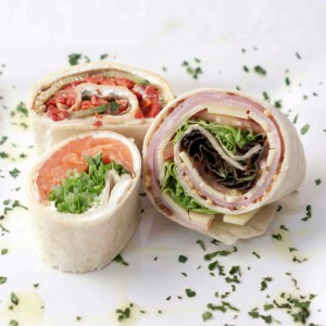 Image of a well served Bite size cocktail wraps by Square Catering