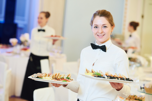 Image of a waitresses offering Office Catering in Sydney