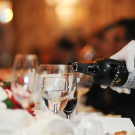 Image of a Butler pouring wine into glass - Corporate Events Catering Company