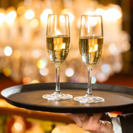 image of a Waiter served champagne glasses on a tray